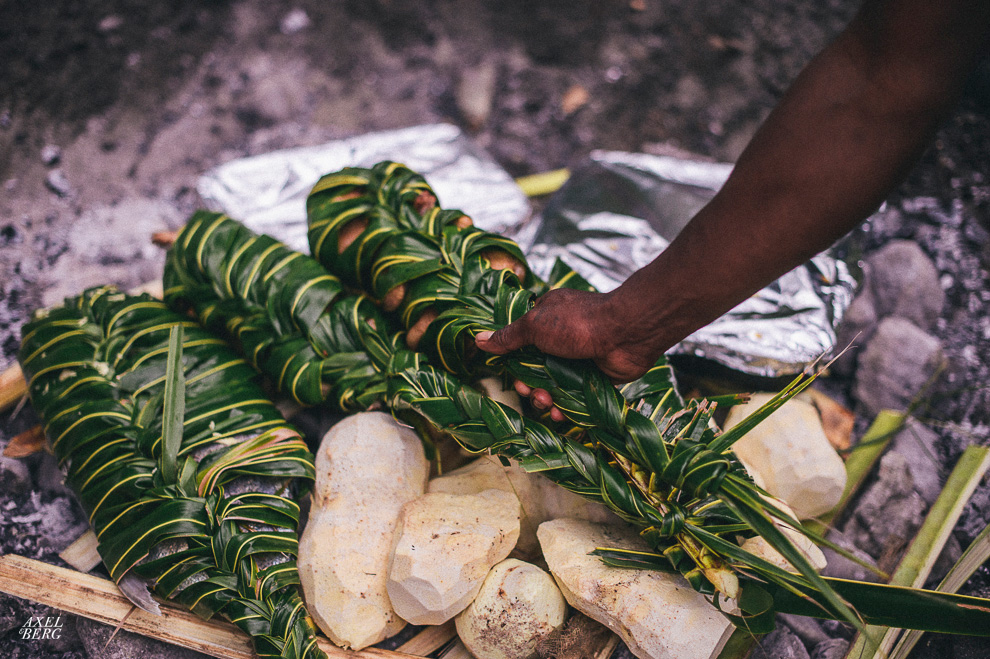 Fish wrapped in Banana Leaves being cooked on Hot Rocks